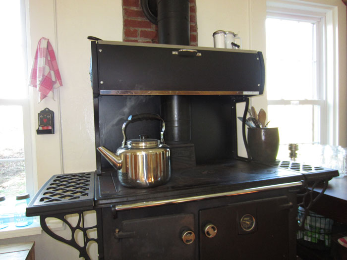tea kettle on cookstove wood cook stove wood burning cook stove