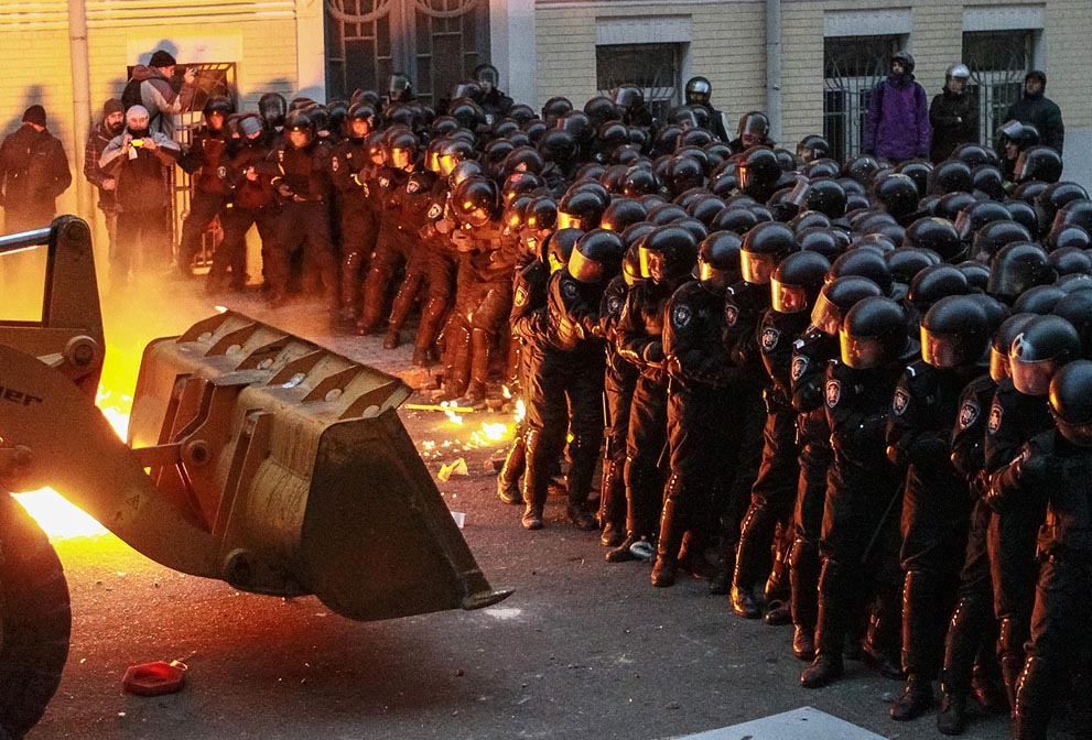 Protesters Use Bulldozer to Push Back Police Lines